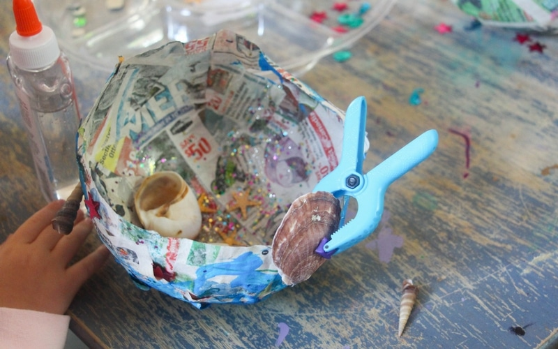 Today, we're returning back to basics with one of my girl's favorite crafts to date, our Mermaid Treasure Bowls, a simple paper mâché craft.