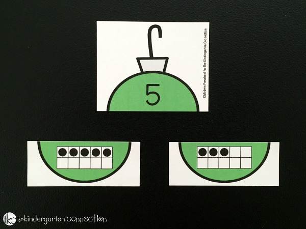 We use ornaments as manipulatives for different learning areas and to go along with dramatic play fun. Add this Christmas Ornament 10 Frame Number Match game into your Christmas theme and practice number skills with your preschoolers or kindergarteners!