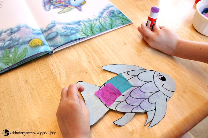 """This rainbow fish craft is the perfect companion to the beloved book """"The Rainbow Fish."""" It is so bright and colorful - kids love it!"""