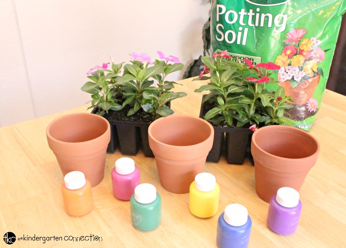 This thumbprint flower pot craft is a perfect spring or summer art activity for kids, and makes an excellent gift as well!