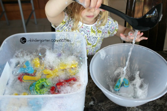 What a fun alphabet sensory bin for preschoolers and kindergarteners! Blow bubbles and have hands on fun with letters and sounds.