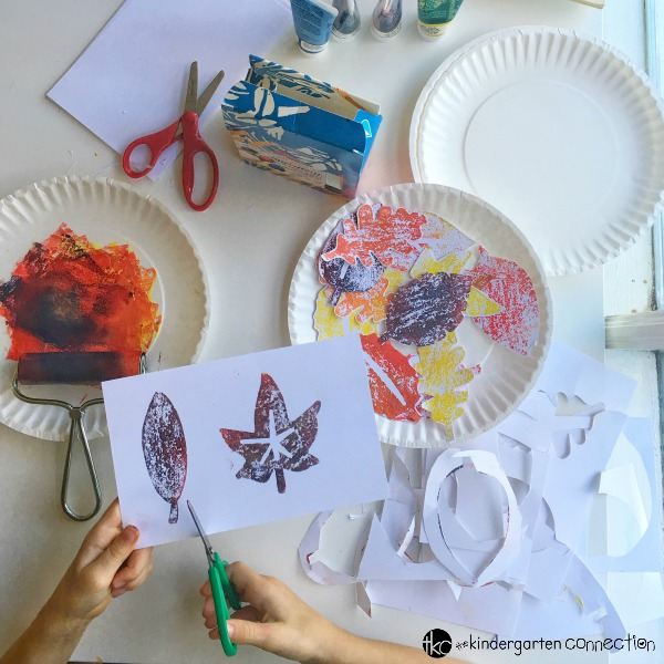 This Autumn canvas art is a wonderful fall project for kids! They will explore color mixing, stamping, cutting, and pasting to create a beautiful display.