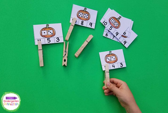 Students simply add the numbers on the dice and clip the correct answer.