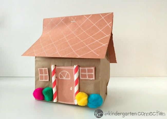 This paper bag gingerbread house craft is a fun project for the classroom! It helps develop fine-motor skills, shape recognition, and following directions while celebrating the holiday season!