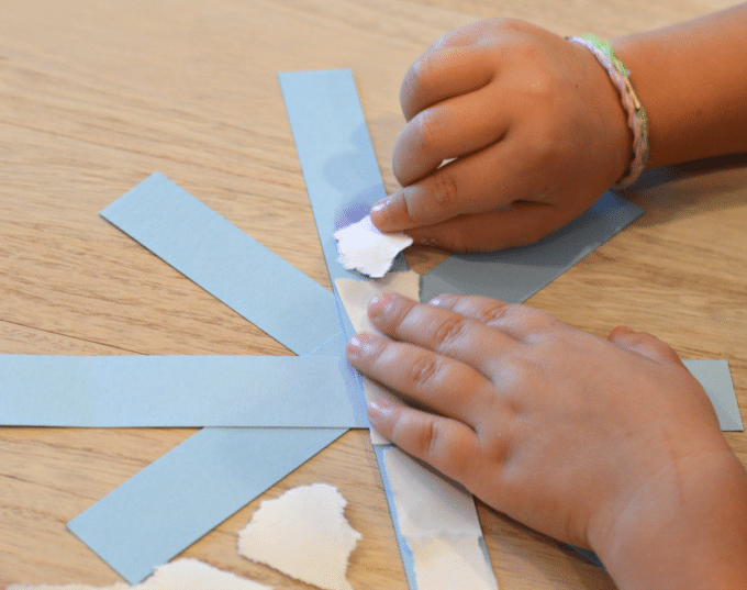 This easy paper snowflake craft is a fantastic and fun craft that also strengthens fine motor skills! It is a perfect winter activity for Pre-K or Kindergarten!