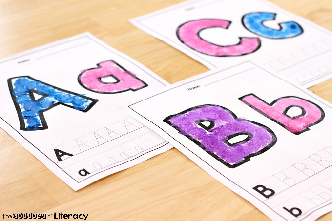 Combine the love of painting, letter practice and fine motor skills development at the same time with this Fine Motor Letter Painting with Pom Poms activity.
