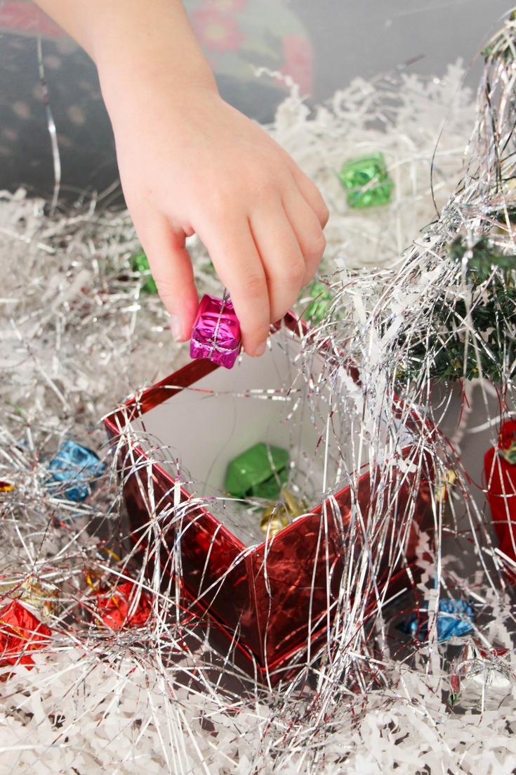 Work on letter identification and beginning reading skills with Pre-K and Kindergarten kids with this fun word building Christmas sensory bin!