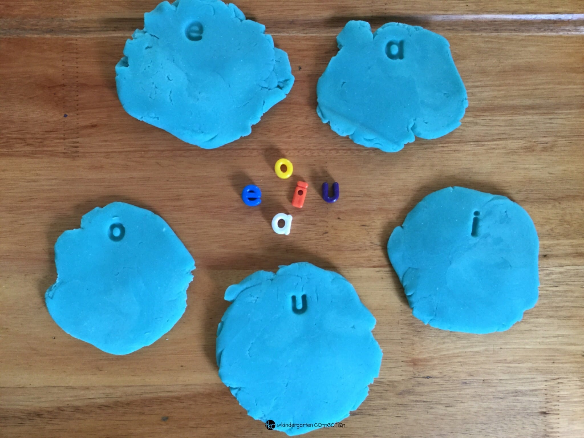 Playdough with letter beads provide all kinds of learning opportunities! We used playdough and letter beads to make clouds, imprinting and sorting vowels.