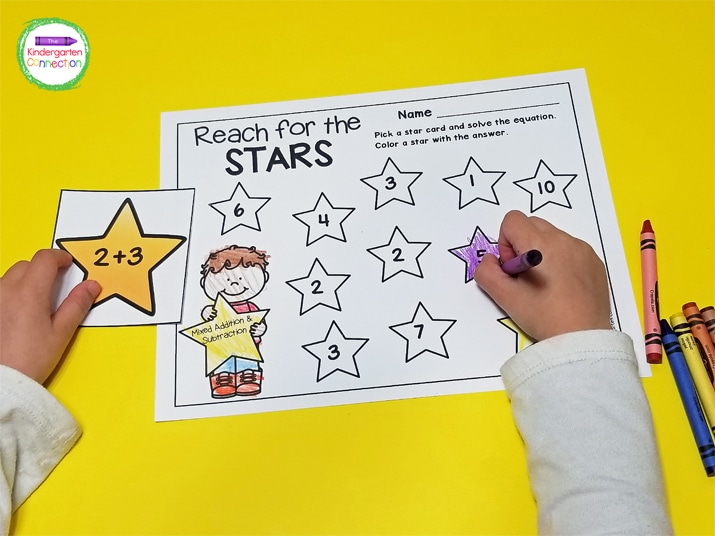 Kids continue to pull stars and solve equations until the recording sheet is full.