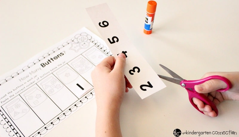 These Button Counting free printables are great for Pre-K & Kindergarten! Set includes a count and write practice sheet and a cut and paste practice sheet!