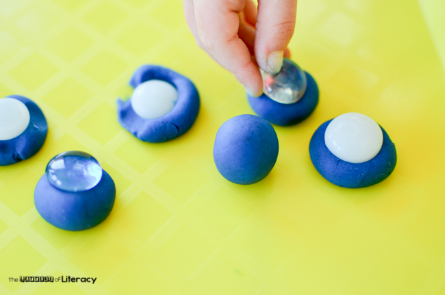 Try this play dough and glass bead pre-writing practice to help little hands develop the muscles and the skills needed for when they are ready to write.