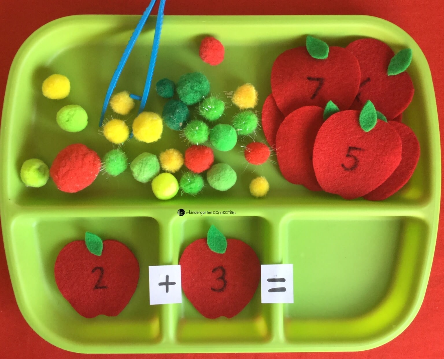 Here's a easy fall hands on addition idea: apple sums! Make numbered felt apples and use pompoms as counters to work on sums.