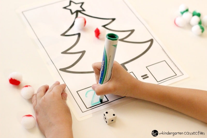 These Christmas addition and subtraction printable math mats are such a fun math center for Pre-K, Kindergarten, or 1st grade!