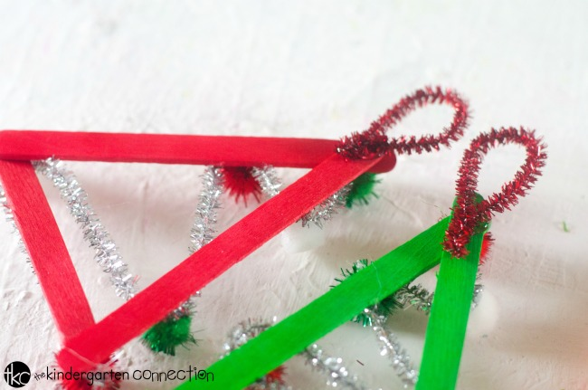 This adorable Christmas Tree Popsicle Stick Ornament is so simple to make and is a great kid ornament to create in the classroom!