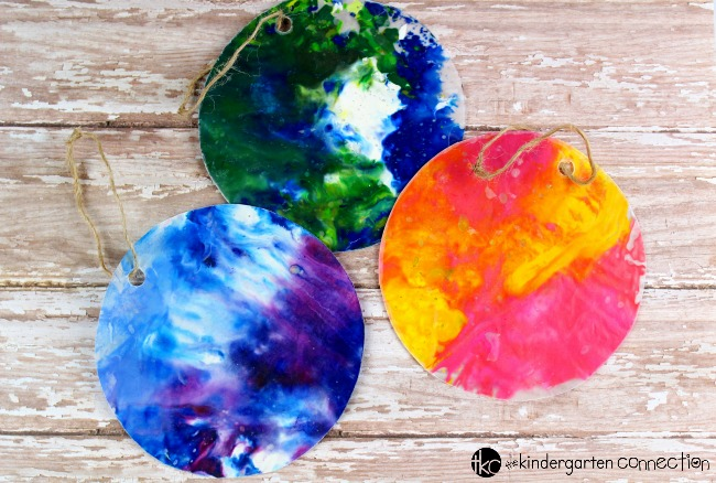 Make these beautiful, hand-made Recycled Crayon Kids' Christmas Ornaments this holiday season and create lasting memories with your children!