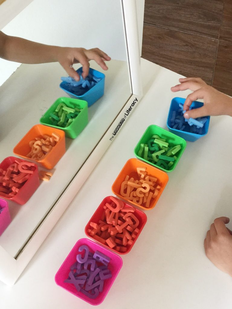 This sticky rainbow spelling activity is perfect for working on spelling and sight words with Kindergarten and 1st grade students! Such a hands-on, multi-sensory way to learn. They will have so much fun with this word work center!
