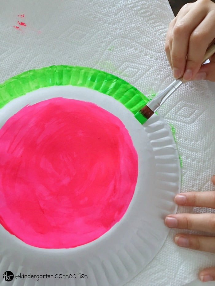 Easy Paper Fan Watermelon Craft for Kids using frugal supplies you already have on hand!