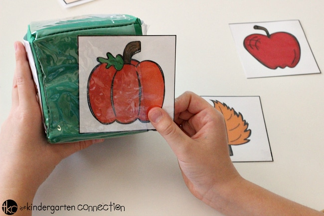Fall Roll and Graph Math Activity FREE Printable is perfect for math centers, or partner work in Pre-K and Kindergarten!