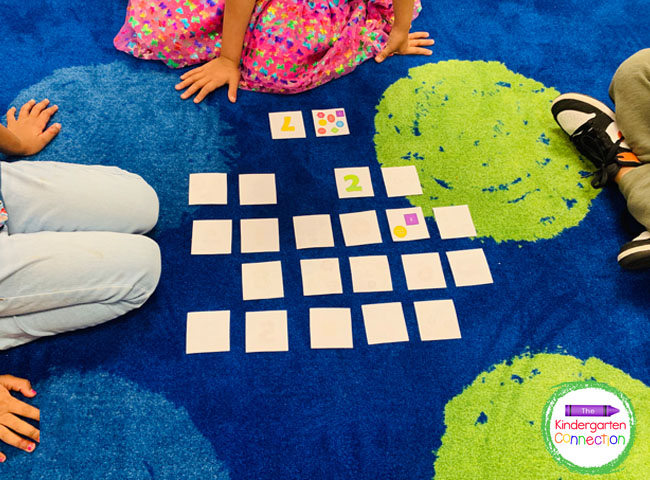 Students will scatter the number cards and button cards face down on the table or floor for this memory counting activity.