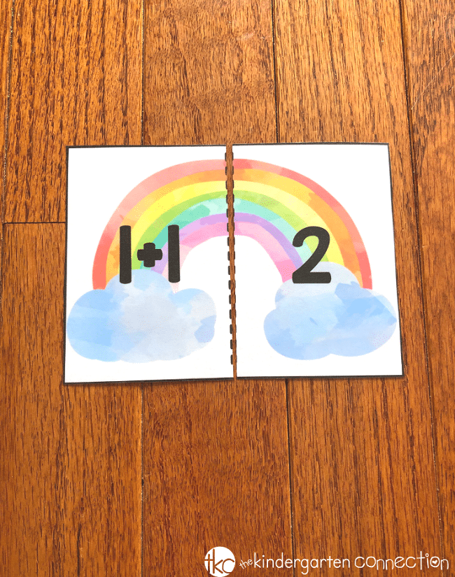 Get our FREE Printable Rainbow Addition Puzzles for Kindergarten! This easy-prep math center is fun to use with a partner or independent practice!