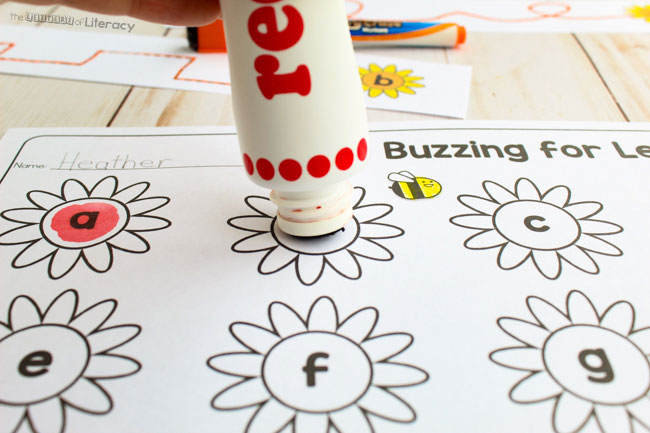 Grab our FREE Printable Pre-Writing Activity for Springtime! You'll also want to see the included Letter Recognition Printable! You can use bingo daubers to find the letters of the alphabet.