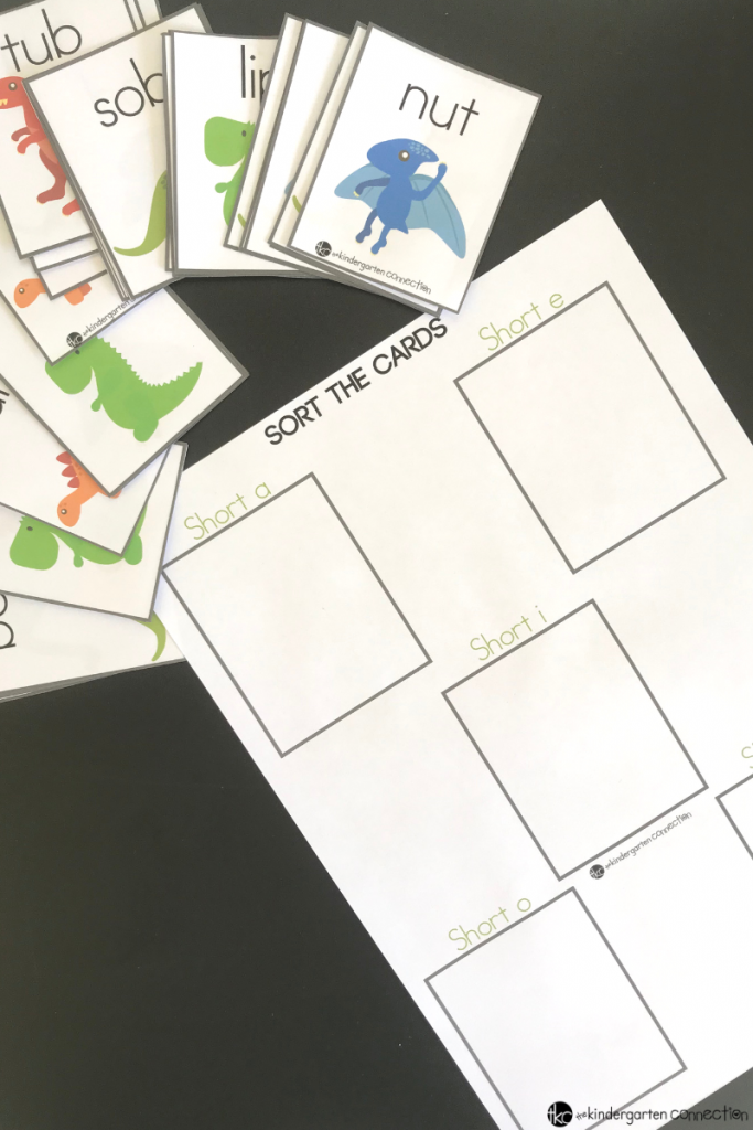 Get our FREE Printable Dinosaur Short Vowel Sort Activity for Kindergarten! These CVC cards are great for small groups and literacy centers!