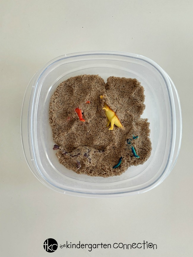 Find out how to make a Dinosaur Mini Sensory Bin that will travel with you wherever you go! Take it on vacation to the beach or in a car ride! Children can sort according to size and color or practicing counting!