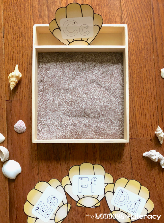 Grab our FREE Seashell Alphabet Printables for this fun Sensory Writing Tray Activity! It's perfect for your literacy OR writing center in your kindergarten classroom!