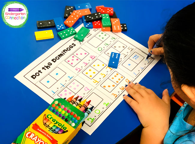 Grab a domino, copy the dots onto the printable, and record the addition sentence underneath!