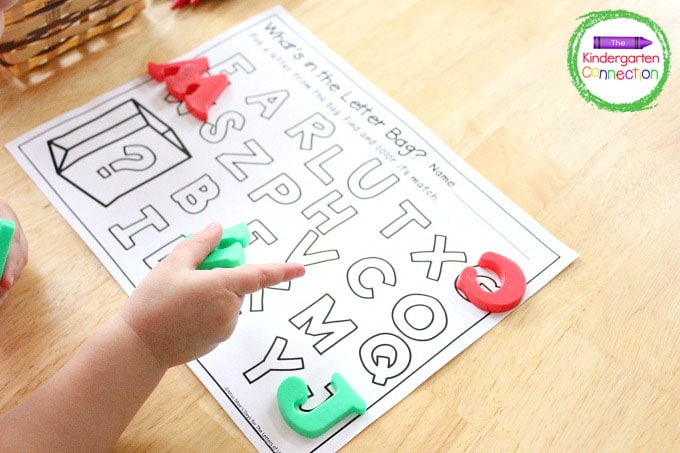 Grab a letter manipulative from the bag and color in the matching letter on the printable.