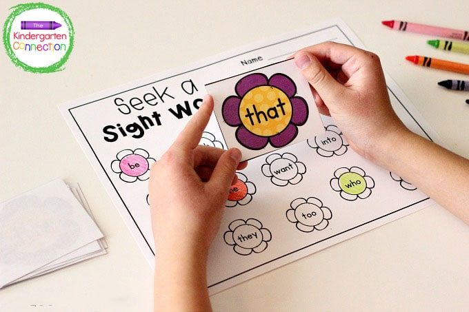 Students will take a sight word flower card from the pile, read it, and color it on the recording sheet.