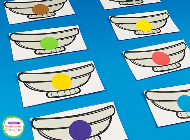 Lay out the number and color bowls or put them in a small pile or basket.