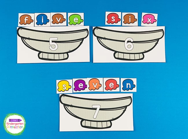 Pick an ice cream bowl card, identify the number or color, and use the letter cards to spell it out.