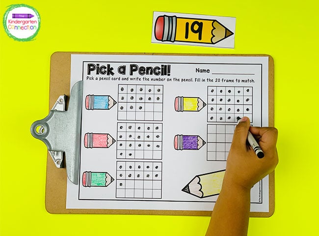 Pick a number pencil card and use a crayon to fill a 20 frame with the correct number of dots.