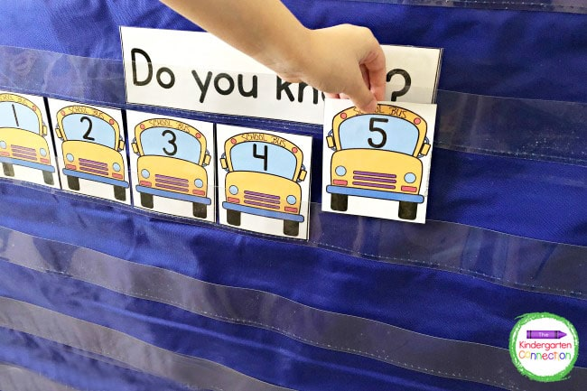 Use the pocket chart to place the school bus number cards in number order.
