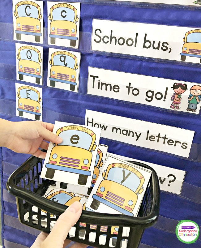 Match the school bus uppercase and lowercase letter cards in the pocket chart.