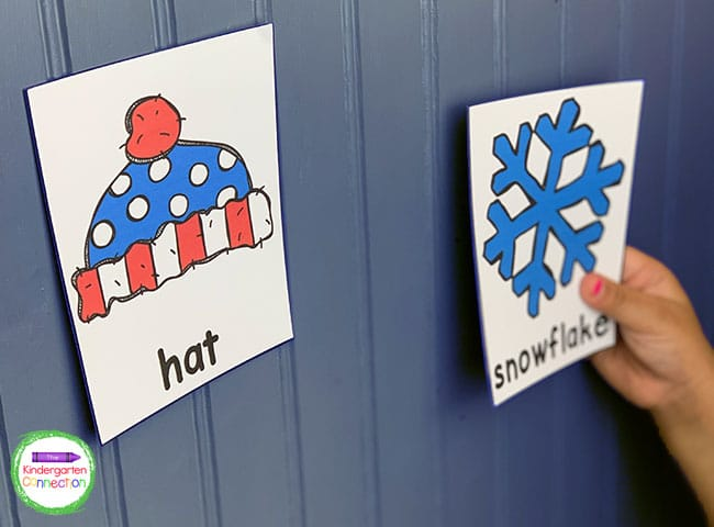 Use velcro or tape to attach the winter vocabulary cards to the walls and other surfaces around the classroom.