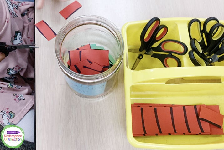 The only supplies you need for this activity is a jar or tub, some scissors, and scrap paper.