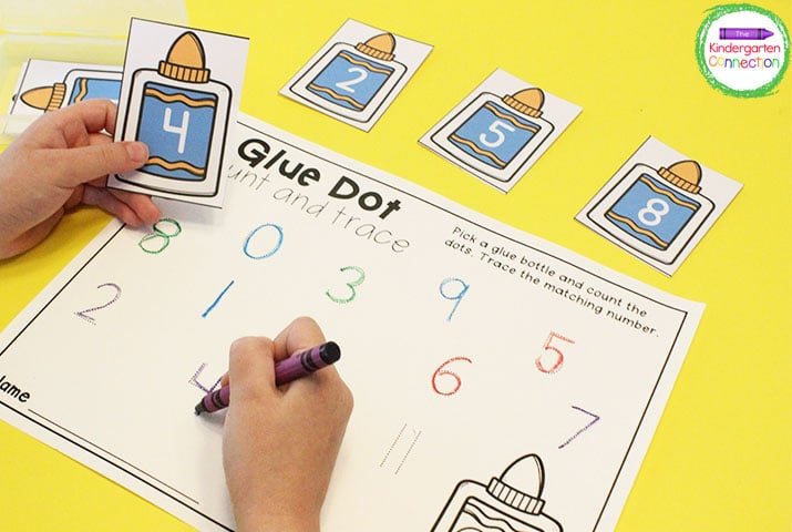 "Students pick a glue bottle number card and trace the matching number on the recording sheet in ""Glue Dot Count and Trace."""