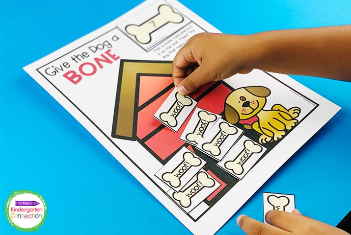 """Use the bone number cards to count how many bones the puppy needs in """"Give the Dog a Bone."""""""