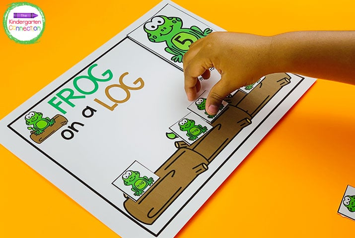 """Students pick a frog number card and add the matching number of mini frogs to the log in """"Frog on a Log."""""""