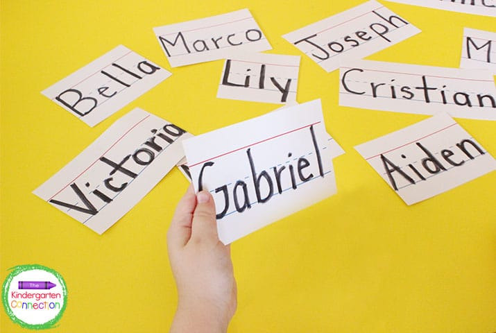 For a successful Kindergarten routine, write all of the children's names on sentence strips to model proper writing.