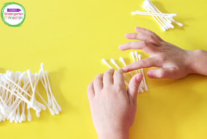 Q-tips can be used to model tally marks and counting skills.
