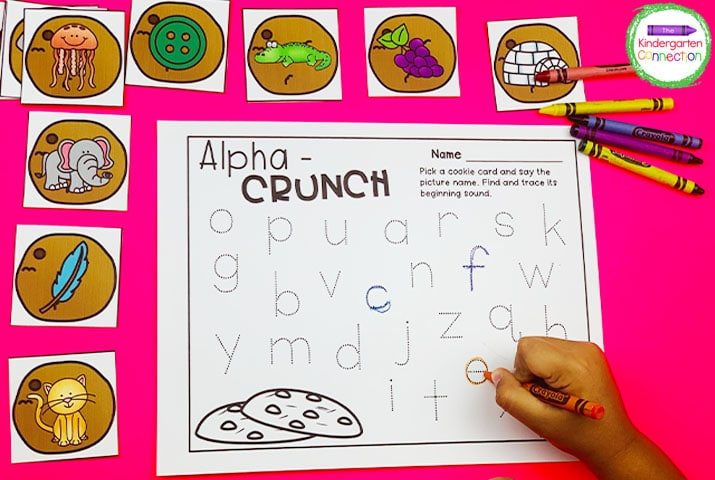 In Alpha-Crunch, draw a cookie picture card and trace the letter that matches the beginning sound.