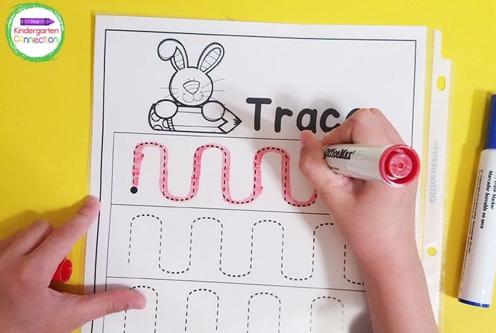 For some added fun, and to save on paper, put the pre-writing printables in dry erase pockets.