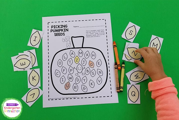 This letter matching activity includes 26 pumpkin seeds with uppercase letters and a recording sheet.