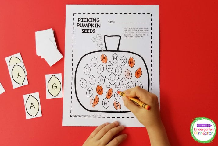 Simply pick a pumpkin seed letter card and color the matching letter on the recording sheet.