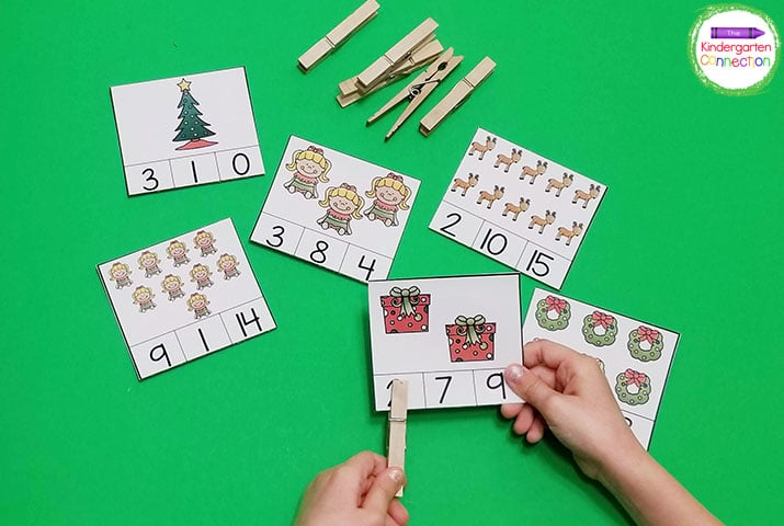 Simply choose a card, count the Christmas objects, and place the clothespin on the correct number!