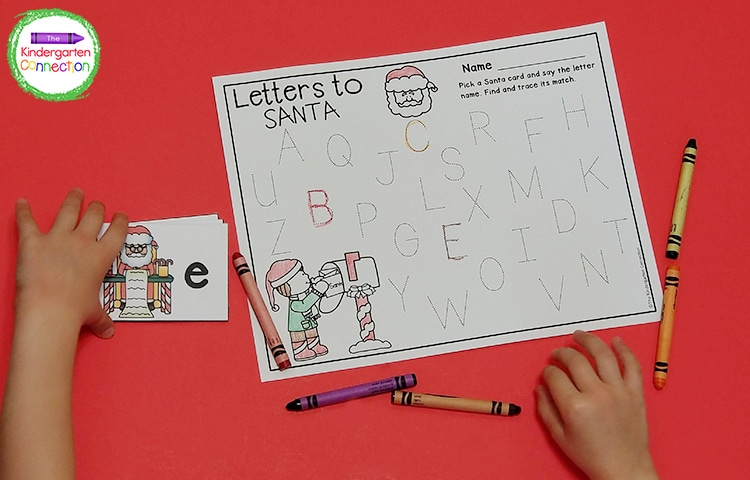 Pick a letter card and trace the letter on the Letters to Santa recording sheet.