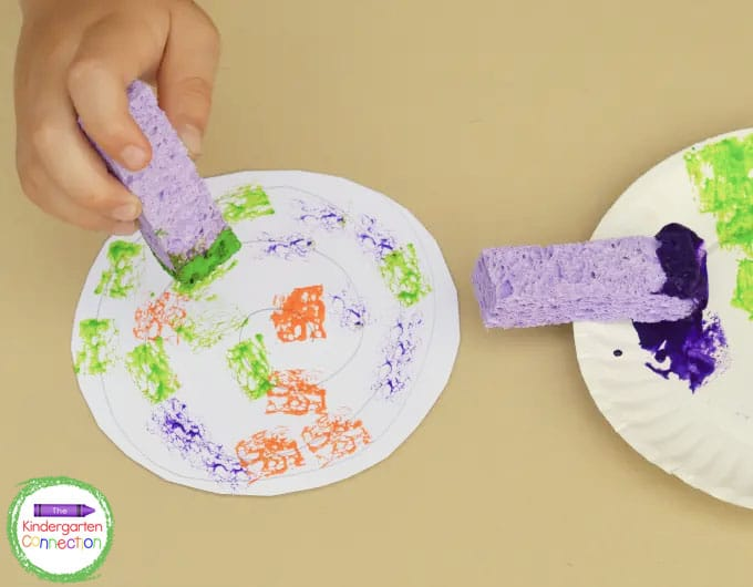 Dab sponges in paint to create a beautiful shell for the hermit crab.